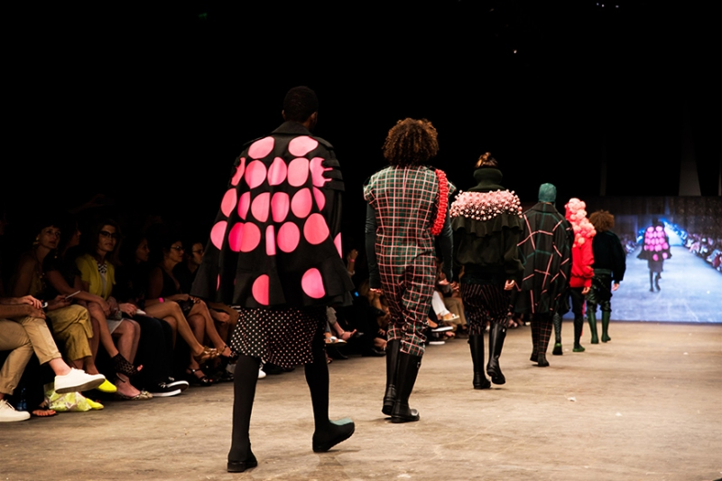 "Presenting menswear collection from Tel-Aviv based fashion designer Roy Drahi's ""Gnomes Liberation Front"", which ranges from kitsch tough, with shades of green, pink and red decorated with pom-poms."